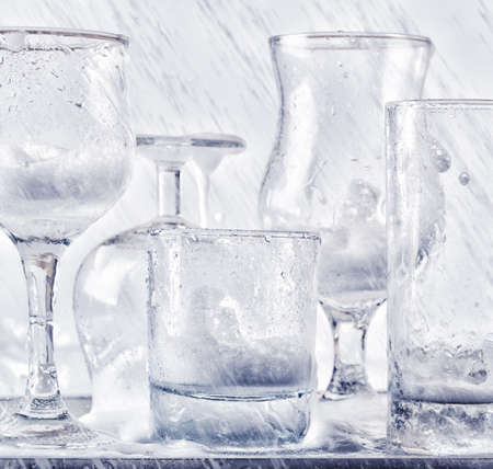 Glassware washing under water jets. Stock fotó