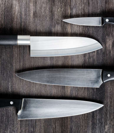 blade cut: Knives on wooden board. Cooking concept.
