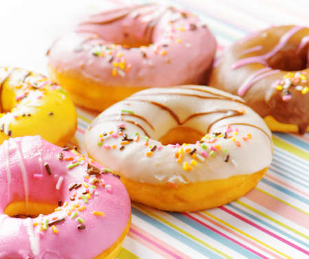Colorful donuts on a striped napkin. photo