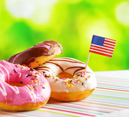doughnut: Colorful donuts with flag of USA. American fast food.