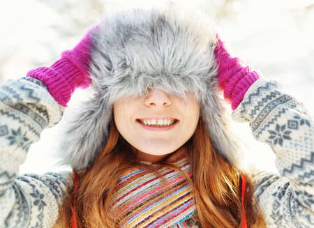 Winter portrait of young woman in fur hat. photo