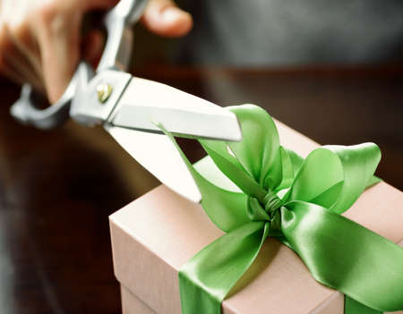 Decorating Gift Box With Green Ribbon Using Scissor Stock Photo Impressive How To Decorate A Gift Box