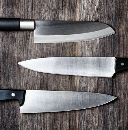 Knives on wooden board. Cooking concept. Zdjęcie Seryjne - 34222206