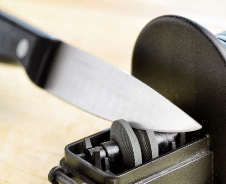 sharpening: Sharpening of knife in a kitchen.