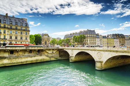 michel: PARIS, FRANCE - AUGUST 12, 2014: View of the Bridge Saint-Michel. The bridge over the River Seine is mentioned in the novel by Victor Hugo, Notre Dame de Paris.