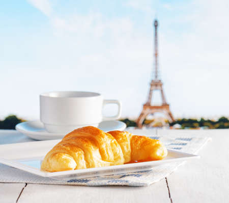 Cup of coffee and croissant in Paris. French cafe. photo