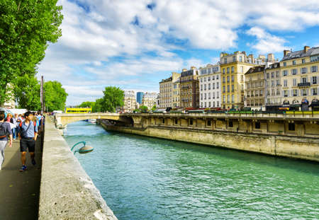 existed: PARIS, FRANCE - AUGUST 12, 2014: View of the Little Bridge. The bridge over the River Seine in Paris has existed on this spot since early history.