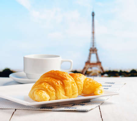 french cafe: Cup of coffee and croissant in Paris. French cafe.