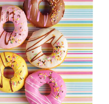 doughnut: Colorful donuts on a striped napkin.