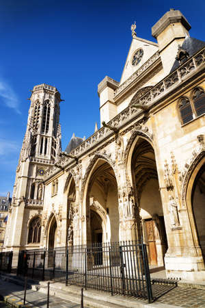 gothic church: gothic arches of western facade of the catholic church of Saint Germain of Auxerre in Paris, France. Paris is one of the most popular tourist destinations in Europe.
