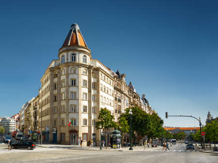 PORTO, PORTUGAL - AUGUST 16, 2014: The crossroads of streets and the Avenue of the Allies (Avenida dos Aliados) in Porto. Porto is one of the most popular tourist destinations in Europe.