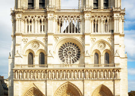notre dame de paris: The main stained glass window in the form of roses above the entrance to the Cathedral of Notre Dame de Paris in France.