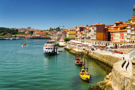 portugal: The Douro River and Colorful facades of old houses on embankment in Porto, Portugal. Porto is one of the most popular tourist destinations in Europe