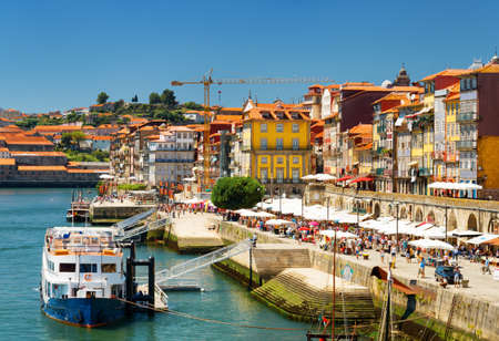 tourist destinations: The Douro River and Colorful facades of old houses on embankment in Porto, Portugal. Porto is one of the most popular tourist destinations in Europe