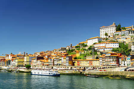 tourist destinations: View of the Douro River and colorful facades of houses of the historic centre of Porto, Portugal. It is one of the most popular tourist destinations in Europe. Editorial