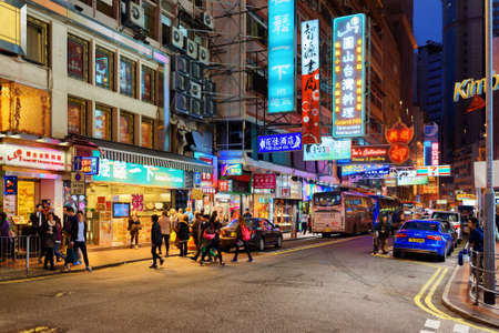 hong kong street: HONG KONG – JANUARY 28, 2015: Illuminated signs on the street of night city. Hong Kong is a leading financial centre of the world.