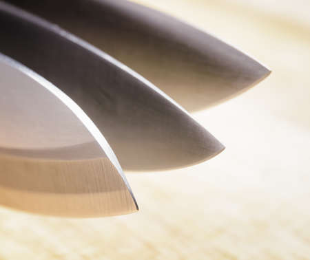 Knives on wooden board. Cooking concept.