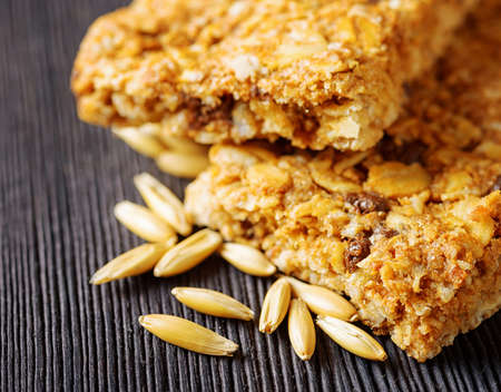 granola bar: Oat granola bars on a wooden table