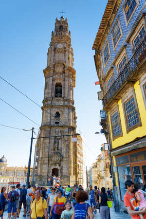 torre: PORTO, PORTUGAL - AUGUST 16, 2014: The bell tower of Torre dos Clerigos is a popular tourist attraction of Portugal.