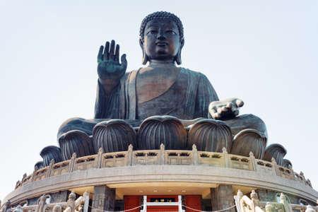 buddha statue: Tian Tan Buddha (the Big Buddha) is a large bronze statue of a Buddha Amoghasiddhi in Hong Kong. Hong Kong is popular tourist destination of Asia. Stock Photo