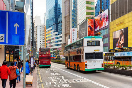 HONG KONG - JANUARY 28, 2015: Decker buses on the central streets. Hong Kong is a leading financial centre of the world.