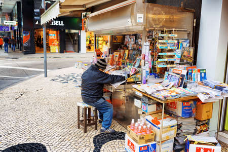 street vendor: MACAU - JANUARY 30, 2015: Street vendor of newspapers in Macau. Macau is a popular tourist attraction of Asia and leading casino market of the world.
