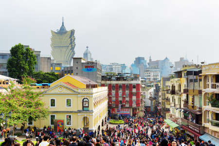 MACAU - JANUARY 30, 2015: Streets of the historic centre of Macau. Macau is a popular tourist attraction of Asia.