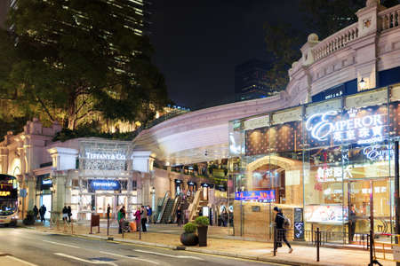outdoor advertising: HONG KONG - JANUARY 31, 2015: Luxury elite stores on streets of night city. Hong Kong is popular tourist destination of Asia and leading financial centre of the world.
