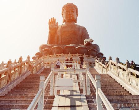lantau: HONG KONG - JANUARY 29, 2015: Tian Tan Buddha (the Big Buddha) in sunlight. It is a large bronze statue of a Buddha Amoghasiddhi in Hong Kong. Hong Kong is popular tourist destination of Asia. Editorial