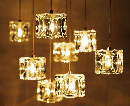 light fixture: Closeup view of contemporary light fixture. Small bright lights creating a festive and romantic atmosphere.