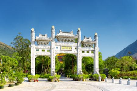 lantau: The white gate leading to the Po Lin Monastery at Lantau Island, in Hong Kong. Hong Kong is popular tourist destination of Asia.