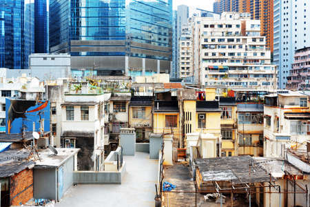 coexist: Old buildings coexist with modern skyscrapers in Hong Kong. Hong Kong is popular tourist destination of Asia and leading financial centre of the world.