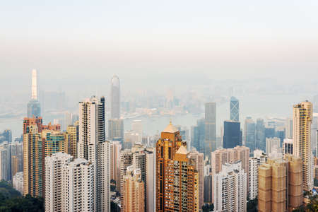 hong: View of skyscrapers in business center of Hong Kong and high houses from the Victoria Peak. Hong Kong is popular tourist destination of Asia and leading financial centre of the world.