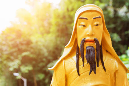 monastery nature: Closeup view of Golden Buddha statue in sunlight in the Ten Thousand Buddhas Monastery on nature background in Hong Kong. Hong Kong is popular tourist destination of Asia.