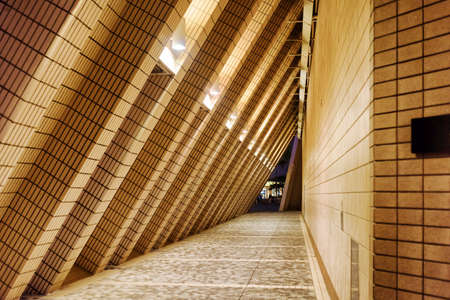 contiguous: Arched tunnel contiguous to a wall of the building of Hong Kong Cultural Centre at evening. Hong Kong is popular tourist destination of Asia and leading financial centre of the world. Editorial