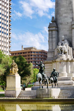 don quixote: The stone sculpture of Miguel de Cervantes and bronze sculptures of Don Quixote and Sancho Panza on the Square of Spain (Plaza de Espana) in Madrid. Madrid is a popular tourist destination of Europe. Stock Photo
