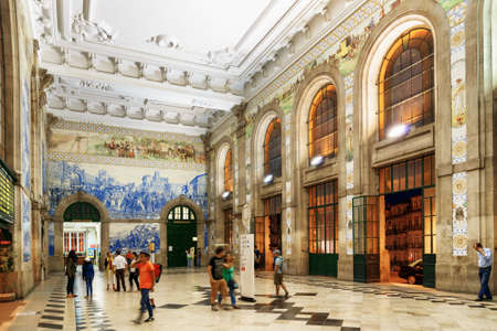 railway history: The main hall with azulejos on walls of the Sao Bento Railway Station in Porto city. The building of station is a popular tourist attraction of Europe.