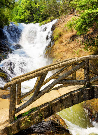 dalat: Wooden bridge over the gorge and the Datanla waterfall in Da Lat city (Dalat), Vietnam. Da Lat and the surrounding area is a popular tourist destination of Asia.