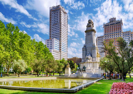 The Cervantes monument, the Tower of Madrid (Torre de Madrid) and the Spain Building (Edificio Espana) on the Square of Spain (Plaza de Espana). Madrid is popular tourist destination of Europe. Foto de archivo