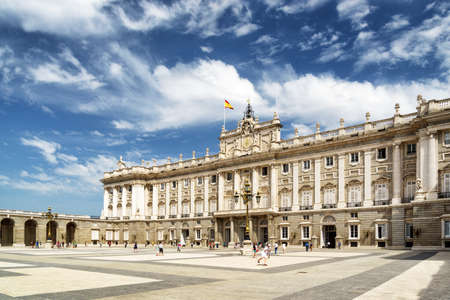 View of the Plaza de la Armeria and the south facade of the Royal Palace of Madrid on the blue sky background with white clouds in Spain. Madrid is a popular tourist destination of Europe. Standard-Bild