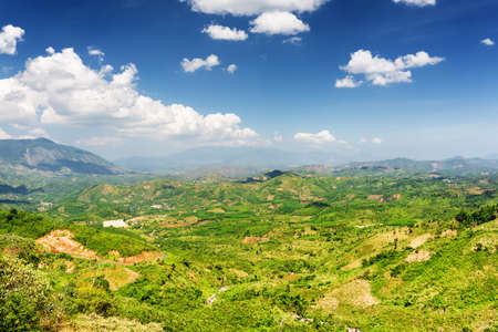 dalat: Beautiful view of the valley on the Langbian Plateau around Da Lat city (Dalat) on the blue sky background in Vietnam. Da Lat and the surrounding area is a popular tourist destination of Asia.