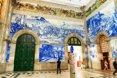 azulejo: Azulejo panels on walls of main hall inside of the Sao Bento Railway Station in Porto city. The building of station is a popular tourist attraction of Europe.