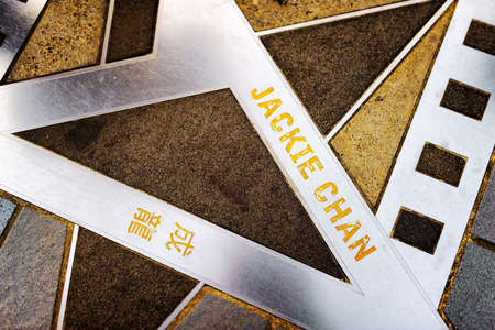 hong: Jackie Chan name and hand prints on the metal star on the Avenue of Stars in Hong Kong