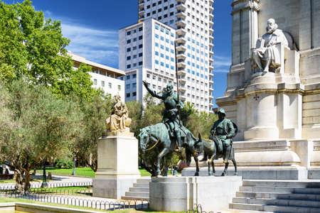 don: View of the stone sculpture of Miguel de Cervantes and bronze sculptures of Don Quixote and Sancho Panza on the Square of Spain (Plaza de Espana). Madrid is a popular tourist destination of Europe. Stock Photo