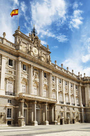 View of the south entrance to the Royal Palace of Madrid on the blue sky background with white clouds in Spain. Madrid is a popular tourist destination of Europe.