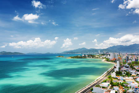 trang: Beautiful view on Nha Trang and Nha Trang Bay of the South China Sea with magic colors of water on blue sky background in Khanh Hoa province, Vietnam. Nha Trang is a popular tourist destination of Asia. Stock Photo