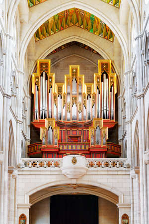 pipe organ: MADRID, SPAIN - AUGUST 18, 2014: View of the pipe organ from place for the parishioners in the Cathedral of Saint Mary the Royal of La Almudena. Madrid is a popular tourist destination of Europe.