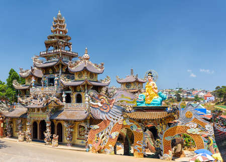 roof profile: View of the Linh Phuoc Pagoda in the mosaic style from shards of glass, pottery and porcelain in Da Lat city on the blue sky background in Vietnam. Da Lat is a popular tourist destination of Asia. Editorial