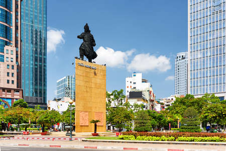tran: Tran Hung Dao statue in Me Linh Square of Ho Chi Minh city in Vietnam. Monument of the military leader on blue sky background. Ho Chi Minh is a popular tourist destination of Asia.