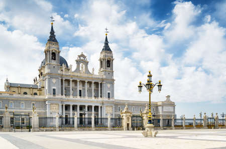 saint mary: View of the Cathedral of Saint Mary the Royal of La Almudena from the Plaza de la Armeria (Armory Square) in Madrid, Spain. Madrid is a popular tourist destination of Europe.
